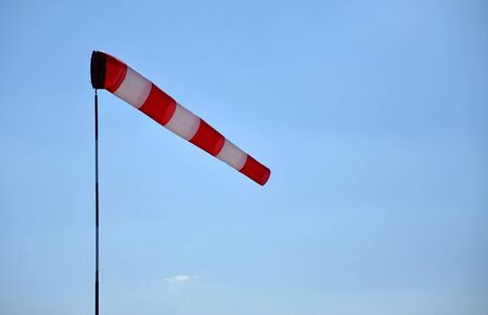 Windsock indicating wind with blue sky and with place for your text photo