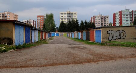 Czech panel buildings with colourful garage doors Stock Photo - 16219256