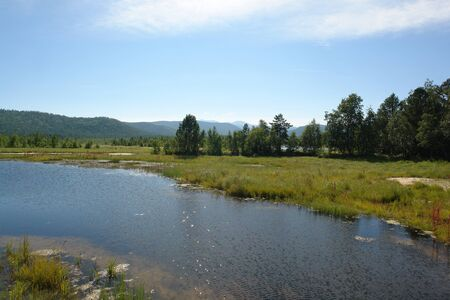 "The Krestovskaya river on a sunny summer day, peninsula Svyatoy Nos (""Holy Nose""), Lake Baikal, Siberia, Russia Imagens"