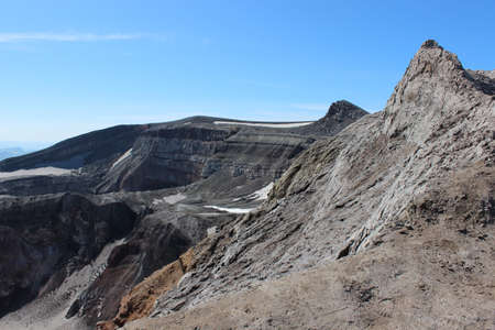View from the edge of a crater to the top (1829 m) of Gorely volcano, Kamchatka Peninsula, Far East Russia