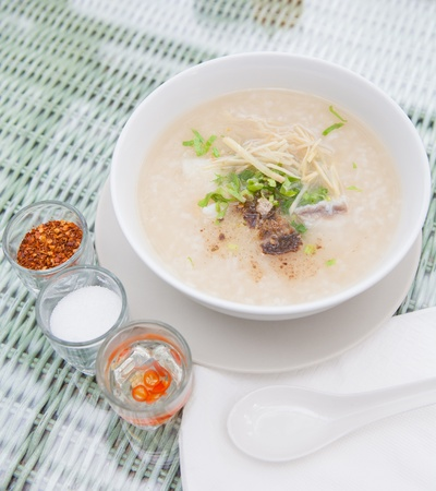 Traditional porridge rice gruel in bowl , Porridge for breakfast menu  Stock Photo