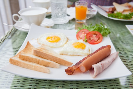 eggs and bacon breakfast plate Stock Photo