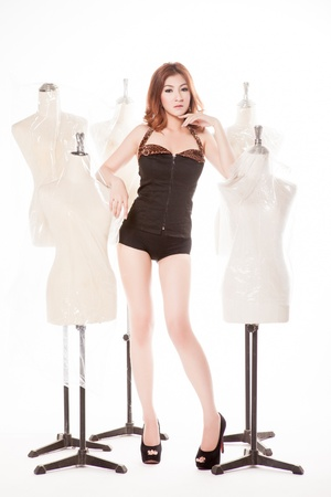 artificial model: Slim woman with Female mannequin,fashion in studio shot