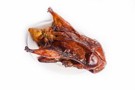 a seasoned roast duck cooked to a perfect golden brown Stock Photo