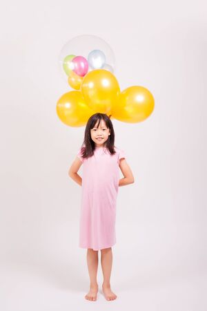 kid and balloons Stock Photo