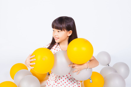 kid play gold and silver balloons