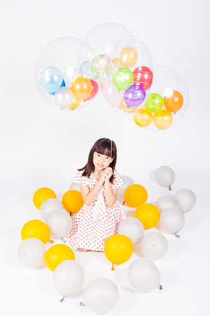 air baby: kid play gold and silver balloons