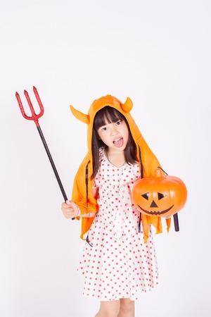 little girl witch  with halloween pumpkin