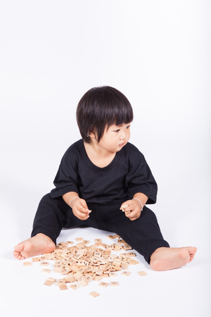 olds: 1 year olds kid play wood alphabet scrabble Stock Photo