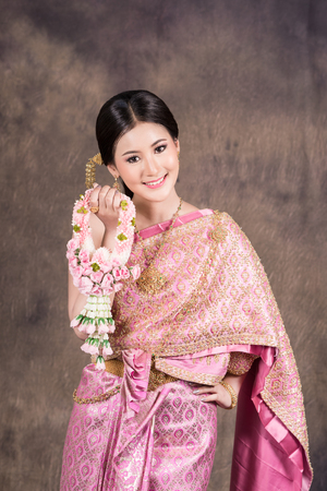 traditional: woman in thai bridal silk dress - traditional costume Stock Photo