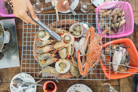 mollusk: Grill mollusk, mussel cooking seafood - selective focus Stock Photo