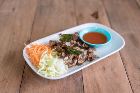 chitterlings: chitterlings grilled on wood table