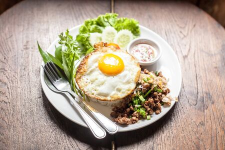 Fried egg with rice  on wooden table