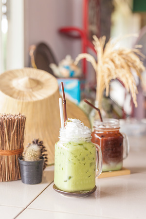 Green tea matcha latte smoothies with caramels and whipped cream