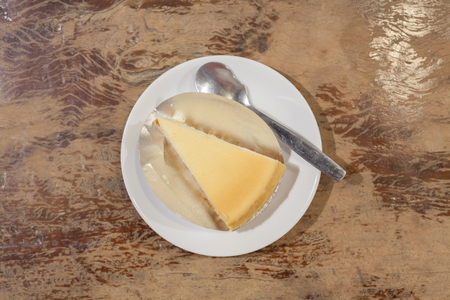 Caramel cheesecake  on the wooden background