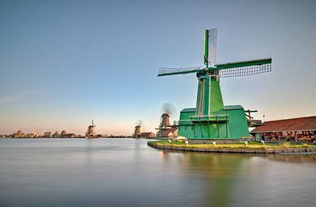 netherland: Row of windmills on the water channels in Netherland Stock Photo
