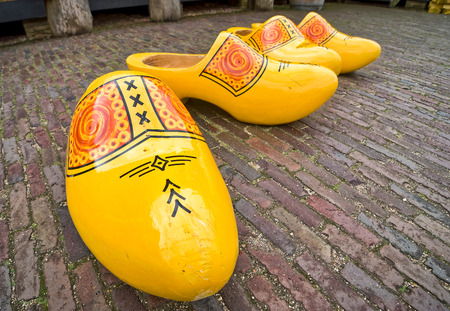 clogs: Bright yellow wooden clogs, traditional Hollands shoes Stock Photo