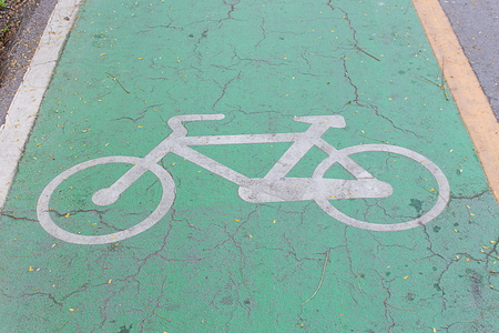 road bike: Bike lane signs painted onto a green bike lane ( Bike lane, road for bicycles )