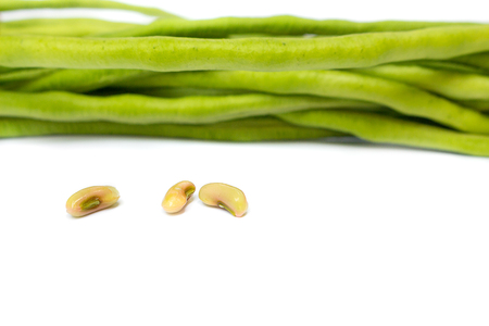 fresh long beans,cow-peas,yardlong bean on a white background, and Blur blurred the background. select focus front nuts.(Vigna unguiculata subsp, esquipedalis)