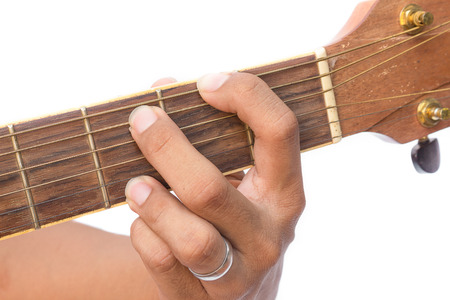 Acoustic guitar guitarist playing. Musical instrument with performer hand, (G major Chord) on white background, select focus front finger catch Guitar strings. (Practicing Chord guitar)
