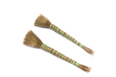 Two Paint brush isolated on a white background, broom brush Tied with rope for painted For painted water building.( select focus front  broom brush )