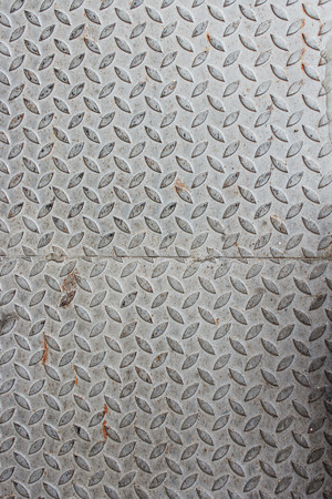 trample: A diagonal pattern on gray metal,  metal texture Table of steel sheet. : space for text and  May You be used as background :