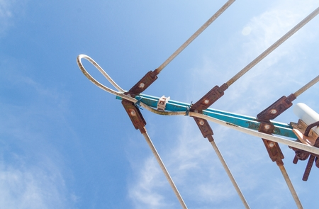 TV antenna, An old television antenna against a blue sky,TV antenna technology obsolescence.