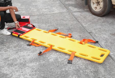 paciente en camilla: physician yellow stretcher  readiness medical equipment. assist a patient in emergency rescue situations.(select focus front stretcher  and soft-focus background) Foto de archivo