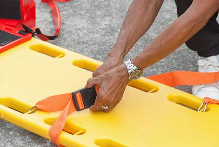physician yellow stretcher readiness medical equipment. assist patient in emergency rescue situations.(select focus front hand physician and soft-focus background) Stock Photo