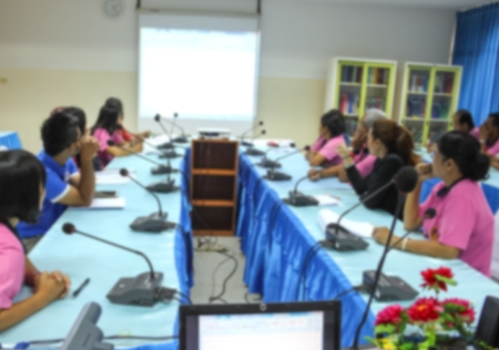 attendee: blurred at Business photo of conference hall or seminar room with attendee background