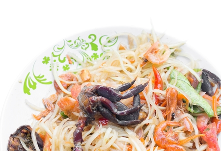 papaya salad  put crab on dish white Isolated background ,Popular local cuisine of Thailand , select focus crab