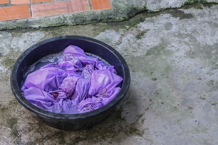 Soak dirty clothes in the basin black for cleanse,Thailand washing clothes style ancient and soaking with detergent.