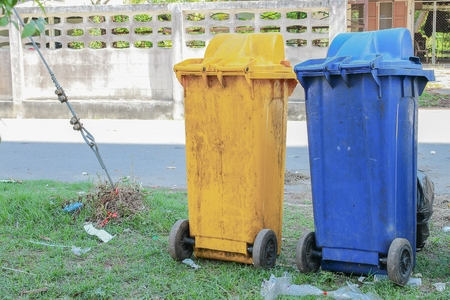 Dustbins in the colors blue, yellow. recycling  of large bins for rubbish. Stock Photo