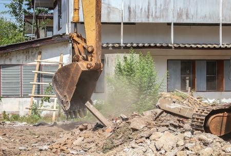 bucket Excavator. excavator destruction in Work outdoor  construction,and  dust soil motion : select focus front bucket Excavator :