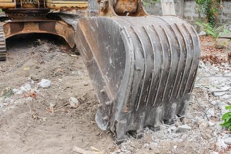 Excavator working.  Close up excavator destruction in Work outdoor construction : select focus front bucket Excavator :