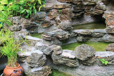 lack of water: waterfall in the garden water dry Lack of care Stock Photo