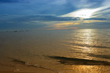 Sunrise reflective light  background. Morning at sea beautiful,  colorful water sea at  reflex. ( Cold Warm Filter) : copy space for add text above and may be used as background :