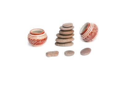 Pyramid  stone and Jug or jar ceramic  glaze on white background Stock Photo