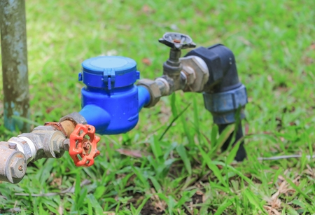 water valve  and  tap pipe  on floor grass, with copy space for add text