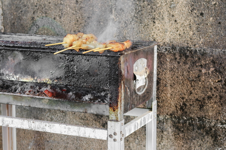pork  cook on the bar-b-que grill  in thai style with fire smoke motion Stock fotó