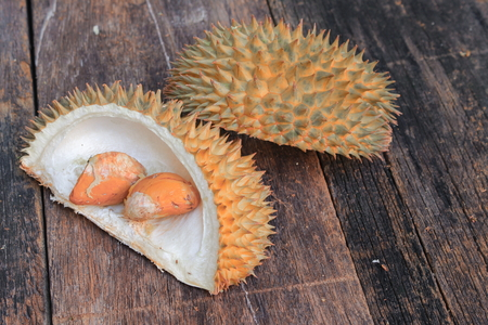shell and seed of Durian fruit on the wood  background Stock Photo