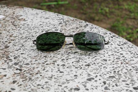 Black sunglasses on Terrazzo floor, marble  table Stock Photo
