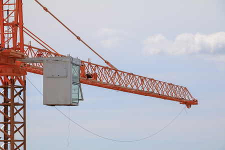 industrial machinery: Tower crane industry selective focus construction buildings site city on blue sky background