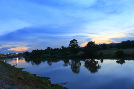 Sunset sky colorful silhouette river  time twilight  woodland nature in Thailand. The last light