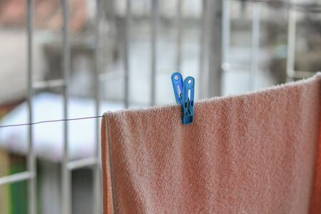 Plastic clothespin pin Close up, and chintz drying on washing line Stock Photo