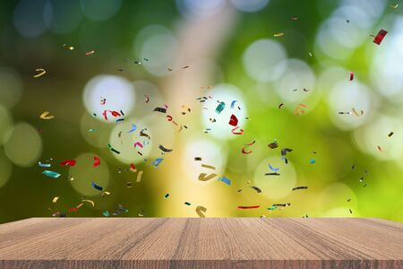 Empty wood table and ribbon motion multicolored,   light bokeh for Christmas  New Year background. with copy space  add  text