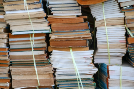 Blurred focus with  Stack of Used Old Books in the School Library Stock Photo
