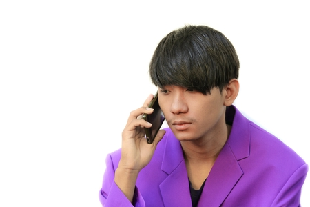 Young handsome business man making a phone call on white background Stock Photo