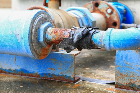 plumbing tube and water leak, steel rust industrial old tap pipe Stock Photo