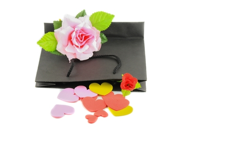 Heart with rose pink and black paper bag on white background valentine day concept
